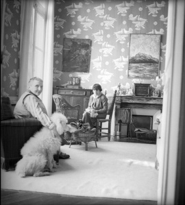 "Gertrude Stein and her partner Alice Toklas with their poodle. Every pet owner looking at this photo just exclaimed, ""A white carpet! Seriously?!"""